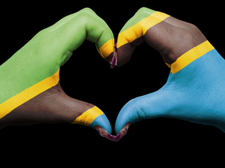 Heart and love gesture by hands colored in tanzania flag for tou