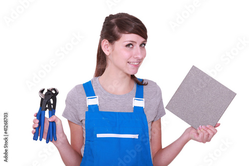 Woman with some pliers and a tile