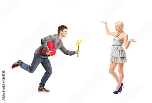 Boyfriend running with flowers and heart shape object towards hi