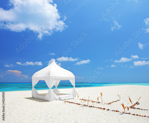 A view of a wedding tent on a beach in Maldives