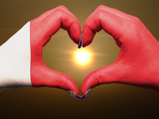 Heart and love gesture by hands colored in bahrain flag during b