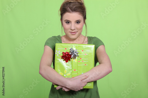 Woman in green with a green present