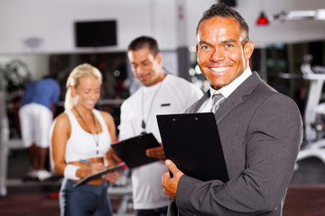 confident gym manager and staff