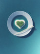 Paradise tropical island in the form of heart in white plate