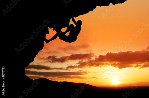 silhouette of free-climber in sunset