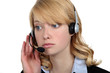 Blond call-center worker listening to customer
