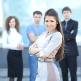 Female Business leader standing in front of her team