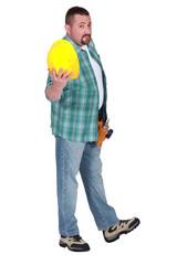 Man showing yellow helmet