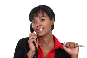 Businesswoman making a call to customer