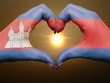 Heart and love gesture by hands colored in cambodia flag during