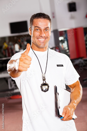 professional male school sports coach giving thumb up