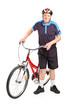 Senior bicyclist posing next to a bicycle