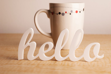 Hello in Front of Cup