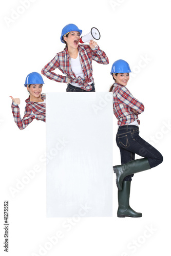 trio of girls wearing blue hard hat