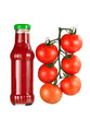 Bottle of sauce and tomatoes