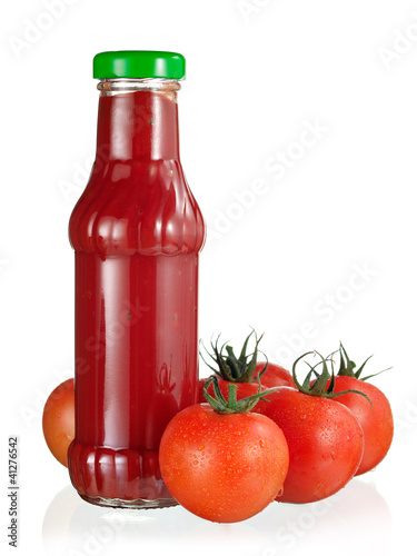 Bottle if sauce and tomatoes