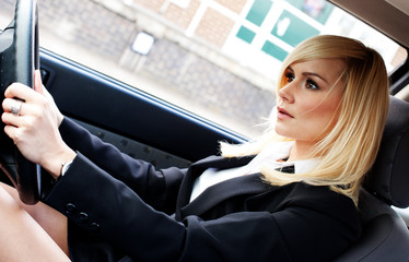 Beautiful businesswoman driving a car