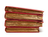 stack of old books with red covers