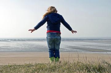child on coastline