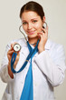 A female doctor with a stethoscope listening