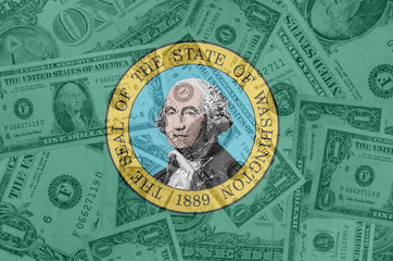 US state of washington flag with transparent dollar banknotes in