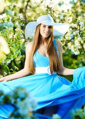 Woman wearing blue dress in amazing fruits garden