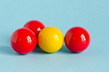 red and yellow billiards ball