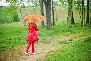 little girl with umbrella outdoor