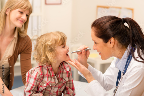 Pediatrician examine child throat look with light