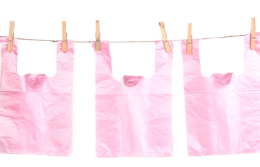 Cellophane bags hanging on rope isolated on white