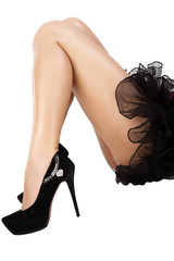 Beautiful women legs in black shoes on white background.