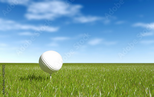 Golf ball green grass and blue sky