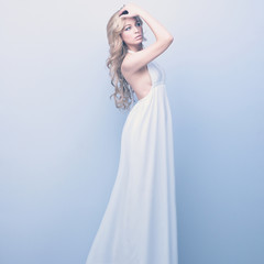 portrait of beautiful elegant blond woman in white dress