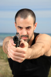 male bodyguard with a gun poster