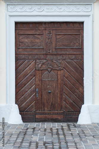 Very old wooden portal with wet ground