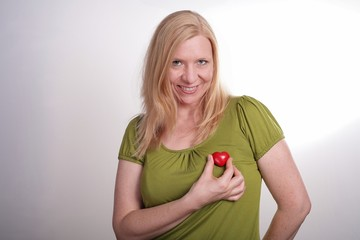 Blonde woman shows her heart