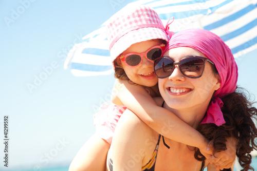 Leinwanddruck Bild girl and her mother at the seaside