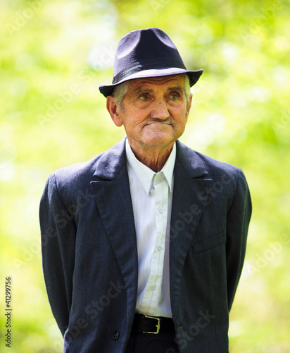 Senior man walking in the forest