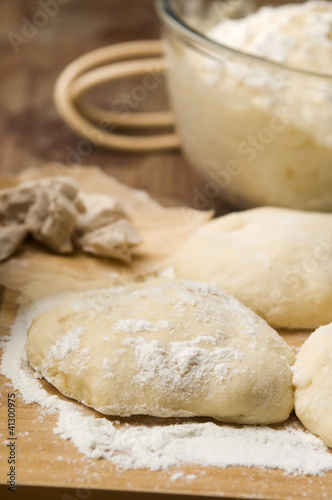 Dough on wooden board
