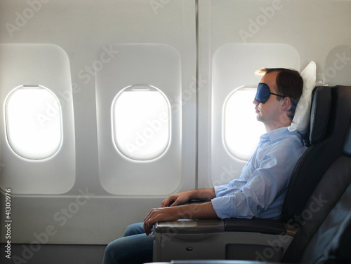 Portrait of man relaxing in the airplane