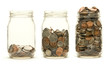 Three glass jars holding coins