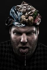 Heap of garbage inside silly man head