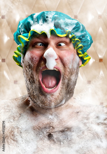 Bizarre man with soap foam on nose