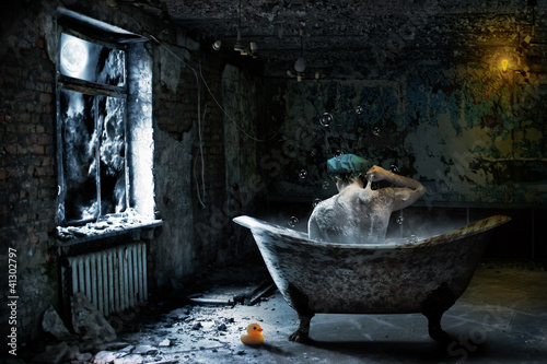 Alone  man in abandoned bathroom