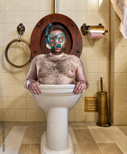 Foto op Canvas Duiken Bizarre man in vintage toilet
