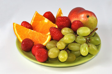 Isolated mix of fruits on plate