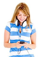 Woman listening to music on cell phone