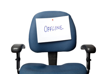 Office chair with an OFFLINE sign isolated on white