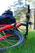 Bike and Backpack Close-up Lying on Green Grass
