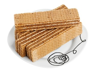 Wafers on a white plate, isolated on white background